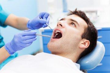 man at dental appointment | red deer county ab