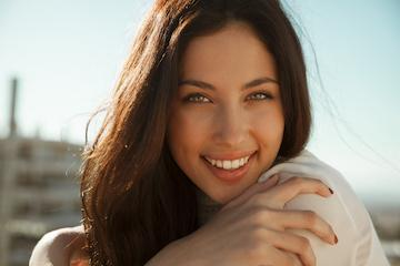 woman in white sweater smiling | Dentist red deer county