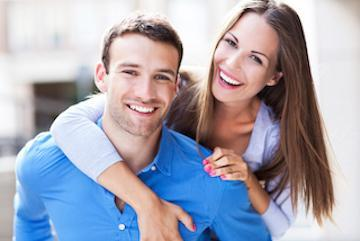 Woman and man smiling and hugging | Dentist Red Deer County